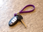 Car key with purple strap